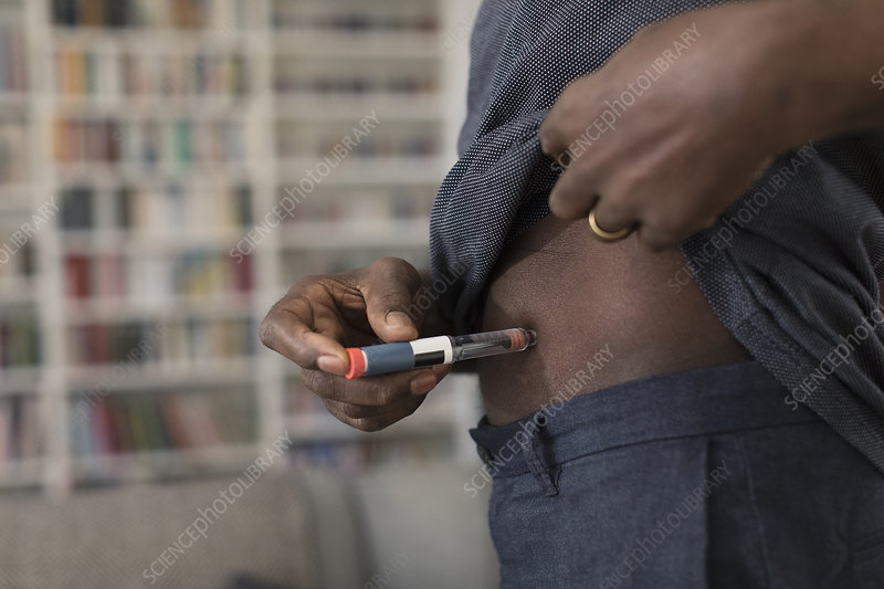 Close up senior man injecting insulin into stomach