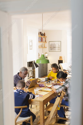 Grandparents with grandchildren doing homework