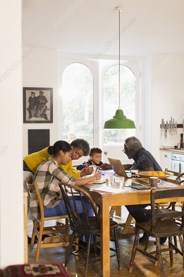 Grandparents helping grandchildren with homework