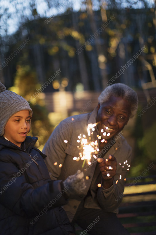 Family playing with firework sparklers