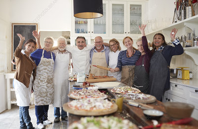 Senior friends and chef taking pizza cooking class
