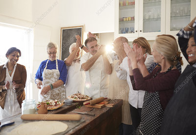 Chef and active senior friends clapping