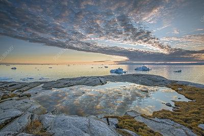 Idyllic clouds over ocean with icebergs, Greenland