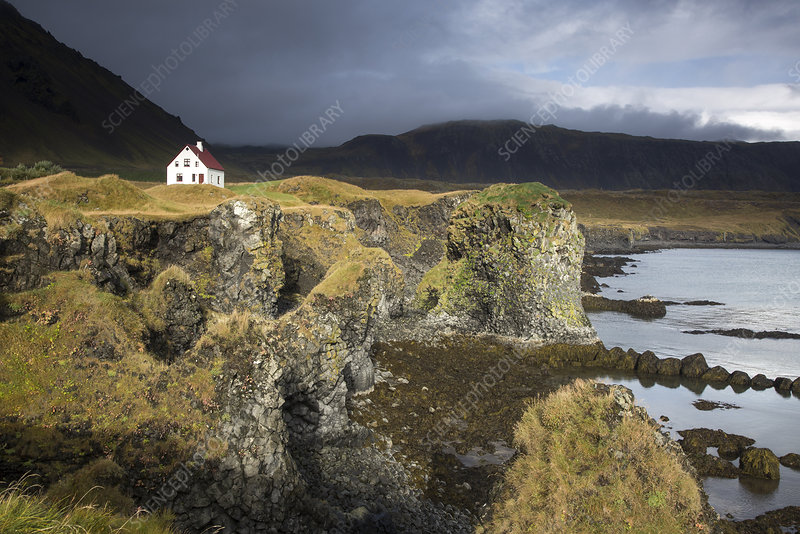 Remote house on craggy, remote cliff, Iceland