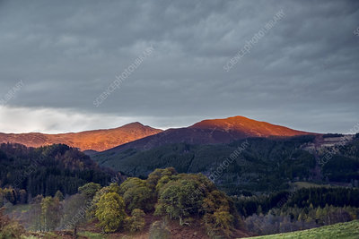 Sunlight illuminating tranquil mountaintops, Scotland