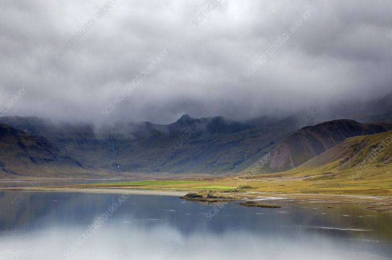 Clouds over remote landscape and water, Iceland
