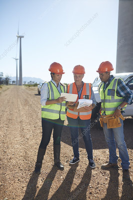 Engineer and workers using digital tablet