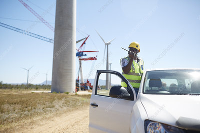 Engineer using walkie-talkie at truck