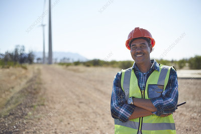 Portrait smiling engineer on dirt road