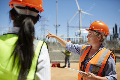 Female engineer talking to colleague