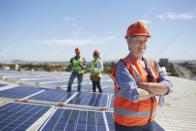 Portrait engineer at sunny solar power plant