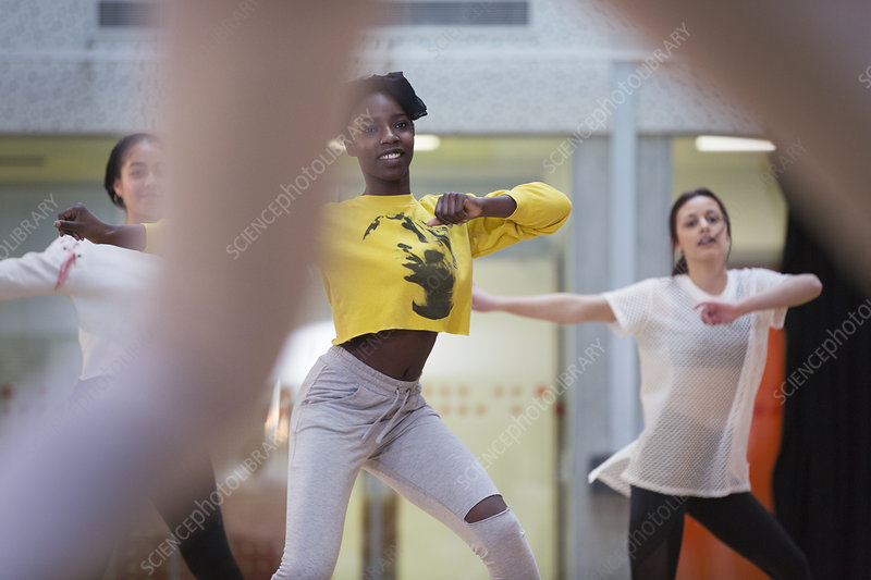 Dedicated teenage girls in dance class in studio