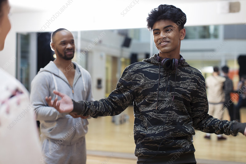 Confident, cool teenage boy in dance class studio