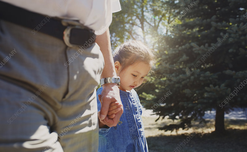 Grandfather holding hands with innocent granddaughter