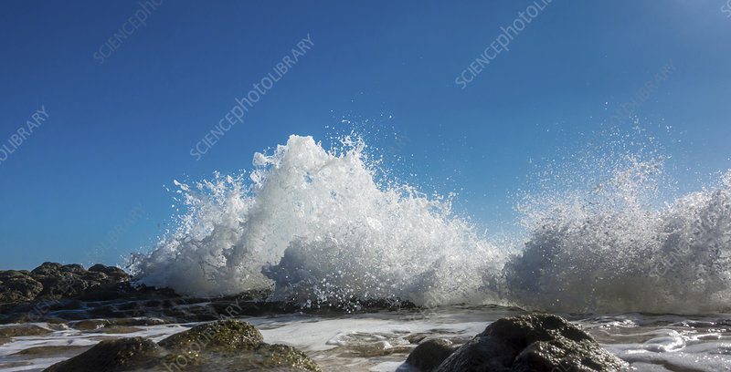 Waves breaking against rocks