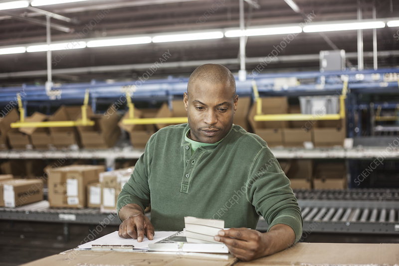 Portrait of warehouse worker in large distribution warehouse
