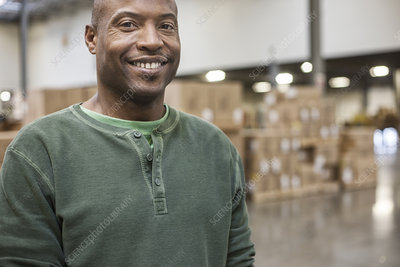 Portrait of worker in a large distribution warehouse