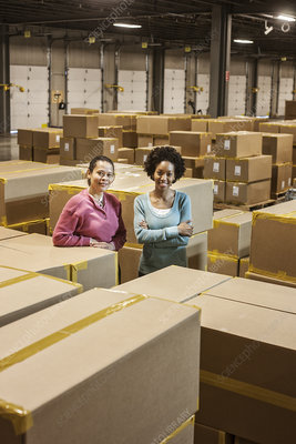 Portrait of workers surrounded by products in warehouse