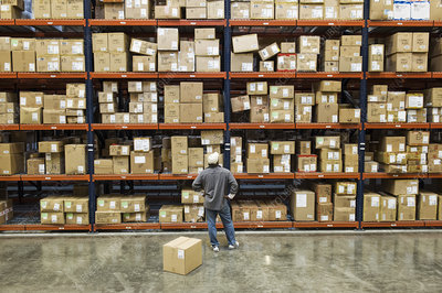 Worker checking inventory in a distribution warehouse