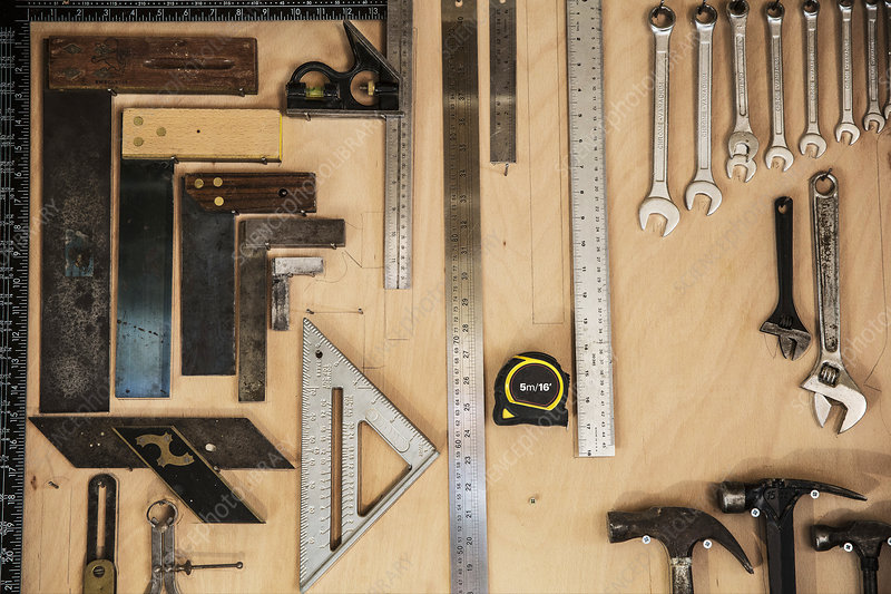 Selection of tools on a wall in a woodworking workshop