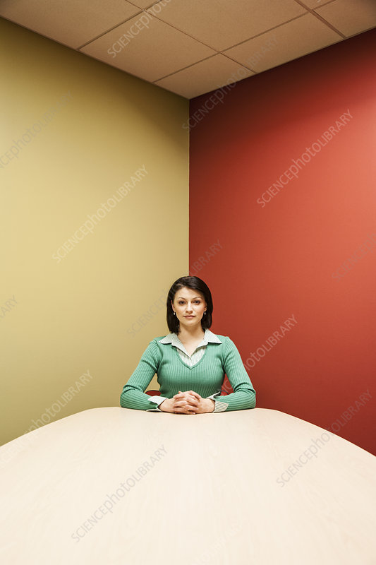 Woman at a colourful conference room table