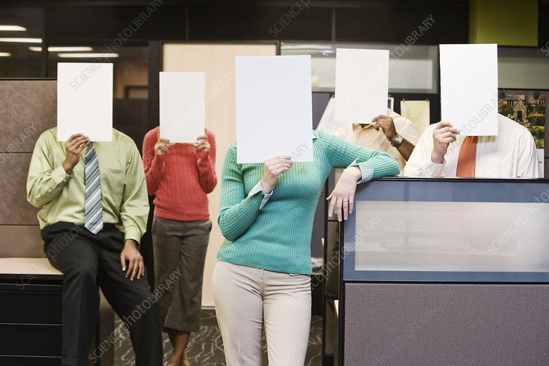 Team standing with blank paper in front of their faces