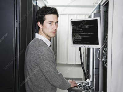 Technician working on servers in a computer server farm