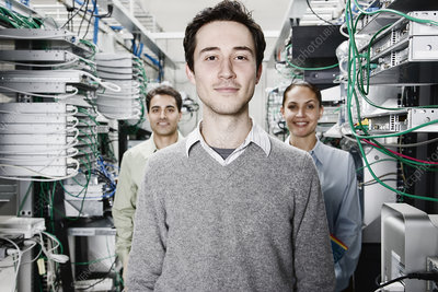 Technicians working on servers in a computer server farm