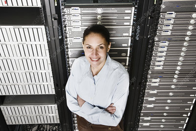 Lab technician working on servers in a computer sever farm