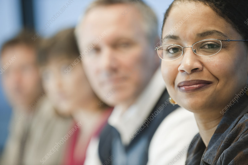 Mixed race team of business people led by businesswoman