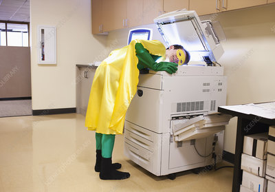 Office superhero at photocopier, making copy of his head
