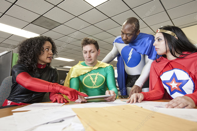 A mixed race team of office superheroes in their office