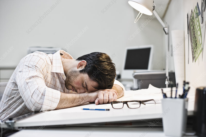 Man taking a quick nap in an architect's office