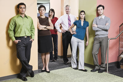 Mixed race team of workers in an office hallway