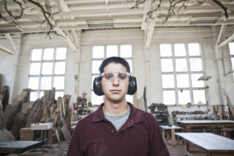 Worker wearing hearing protection in a woodworking factory