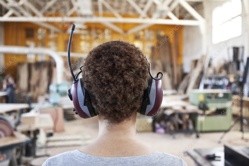 Worker wearing hearing protection in woodworking factory