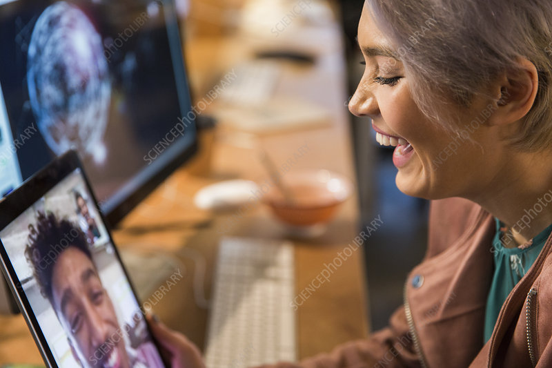 Laughing businesswoman video chatting