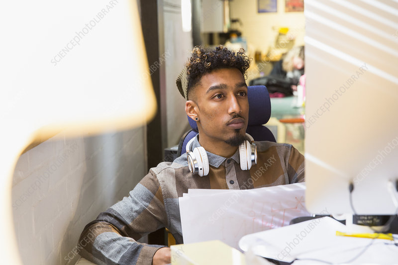 Focused creative businessman working at computer in office
