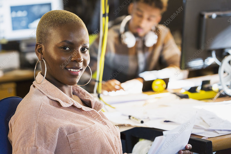 Portrait smiling creative businesswoman in office