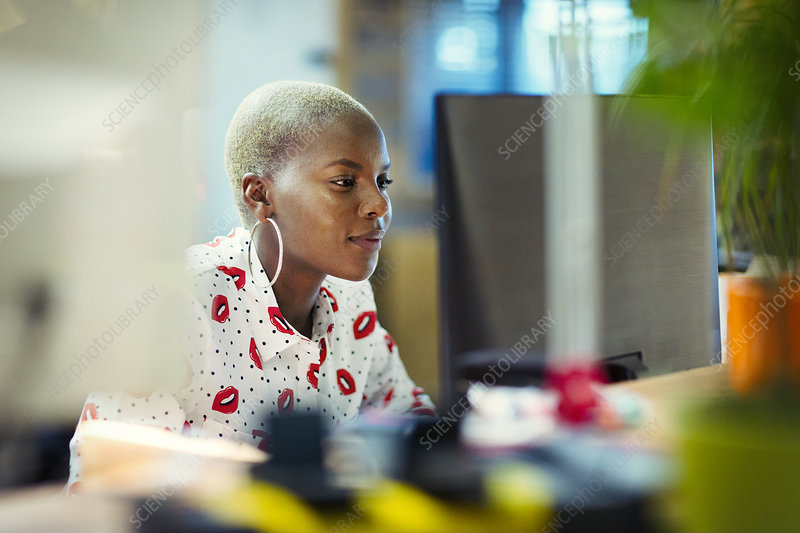 Focused businesswoman working at computer in office