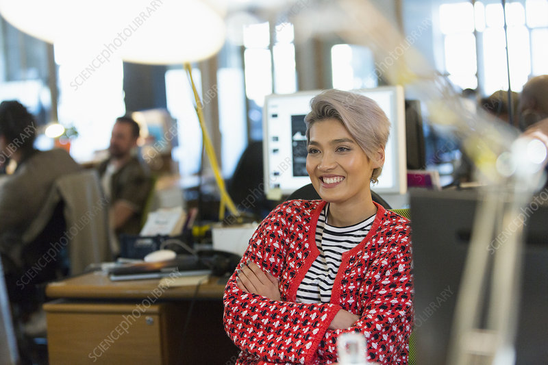 Smiling creative businesswoman working in office