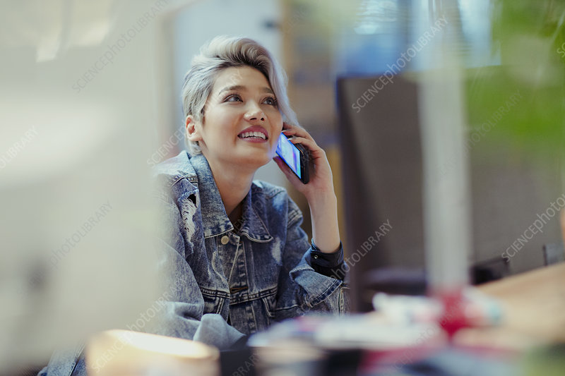 Creative businesswoman talking on smart phone