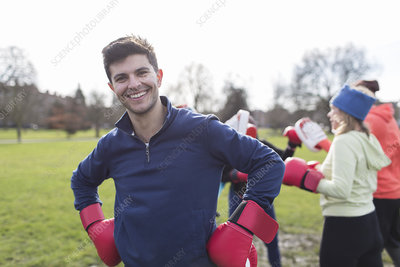 Portrait smiling man boxing in park