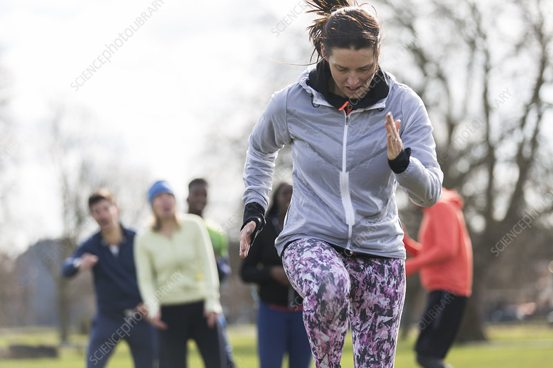 Focused, determined woman exercising in park