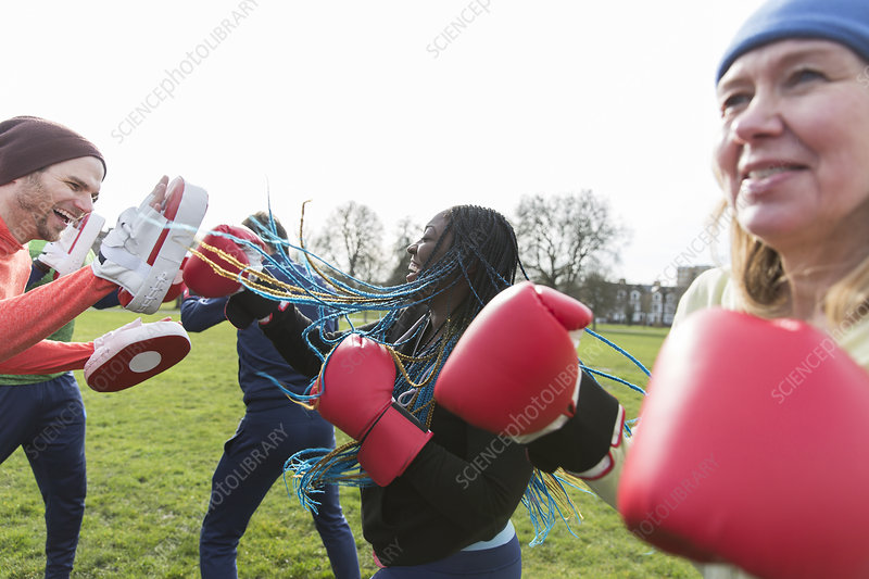 People boxing in park