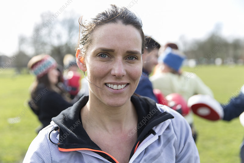 Portrait confident, smiling woman exercising in park