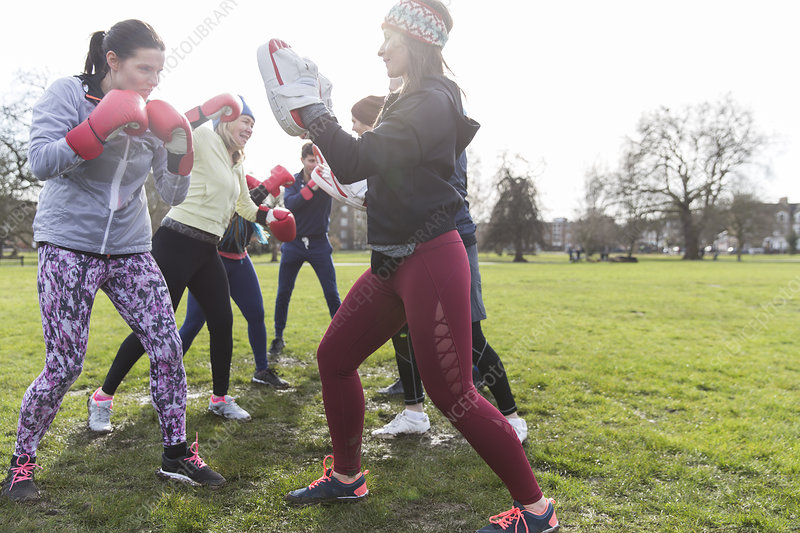 Women boxing in park