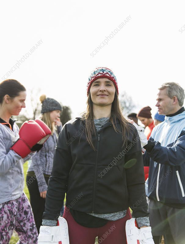 Portrait confident woman boxing in park