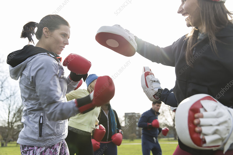 Determined women boxing in park