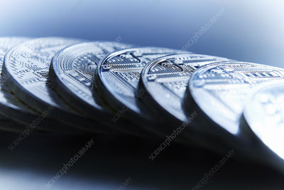 Bitcoins on blue background